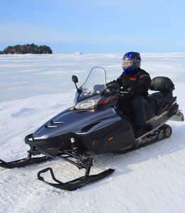 Guided half-day snowmobiling ride